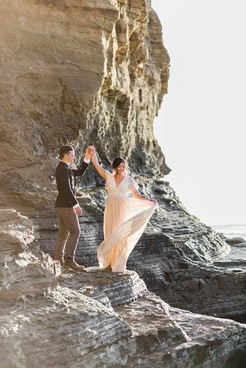 dancing couple in sunset cliffs park for elopement ceremony