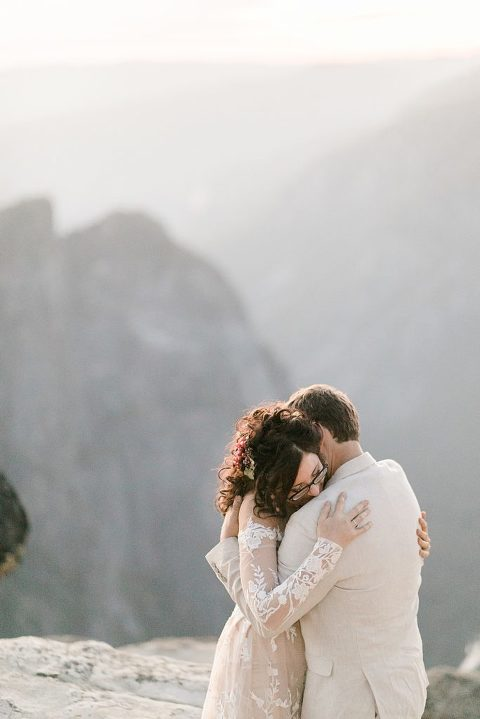 Hugs after wedding vows in Yosemite