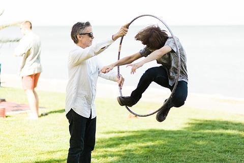 Kid jumping through hula hoop