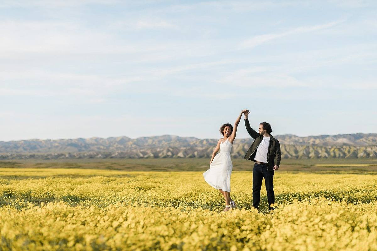 Bride spinning in wildflowers for Carrizo Plain elopement location