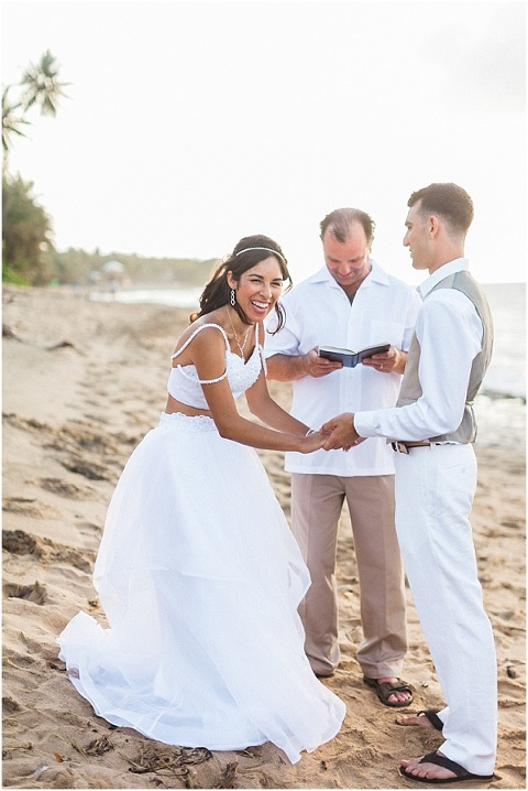 Bride laughing during beach ceremony