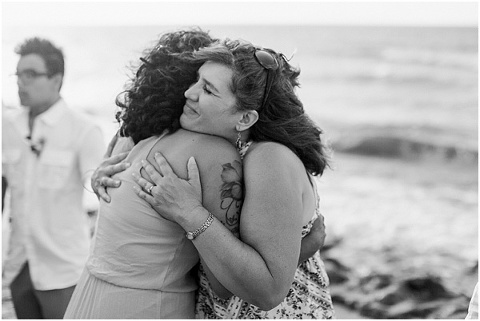 Hugs after beach ceremony
