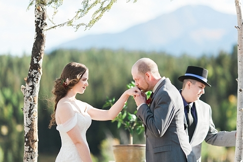 Groom kissing the Bride's hand during ceremony