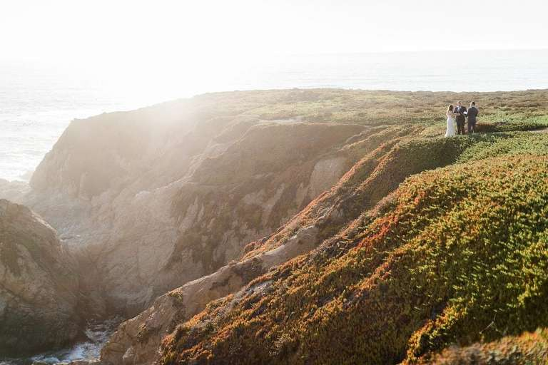 Sweeping views of couple getting married on a Big Sur cliff