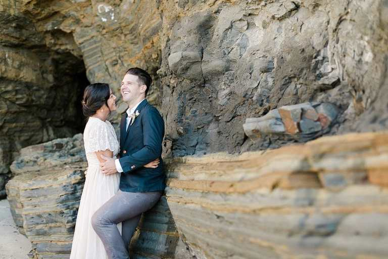 elopement couple laughing by the cliff walls