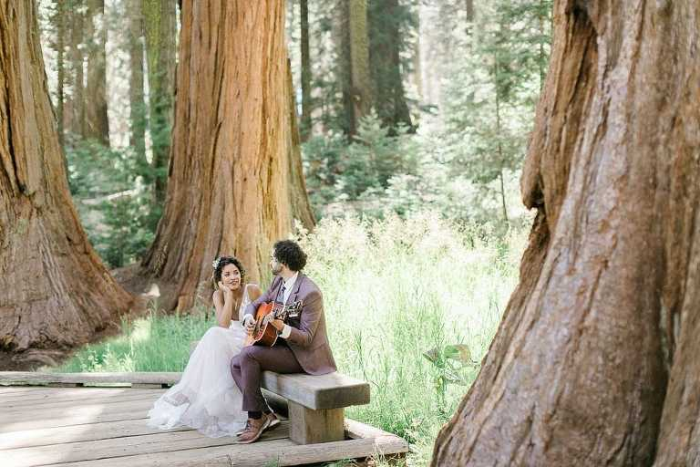 Groom playing his guitar during Sequoia Elopement in California