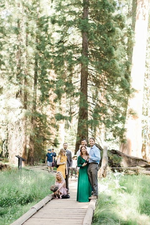 Guests watching as groom plays guitar at Sequoia National Park elopement