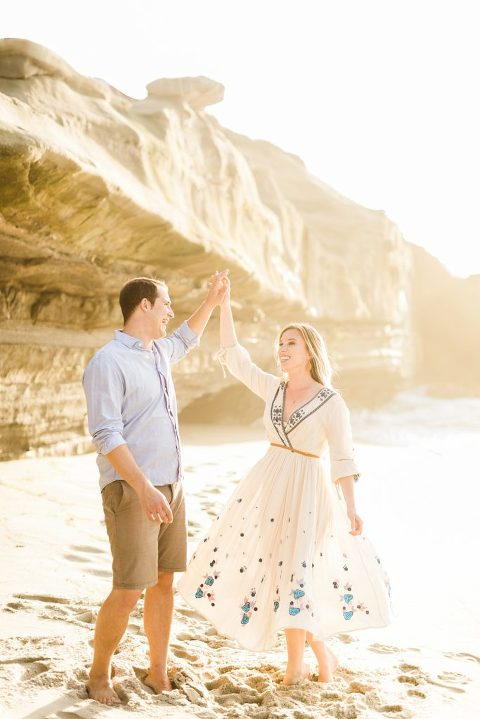 Engagement pictures at Wipeout Beach, La Jolla, CA during golden hour