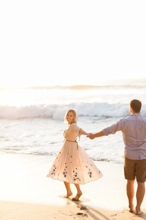 Boho Engagement pictures at Wipeout Beach, La Jolla, CA during golden hour | Free People Dress