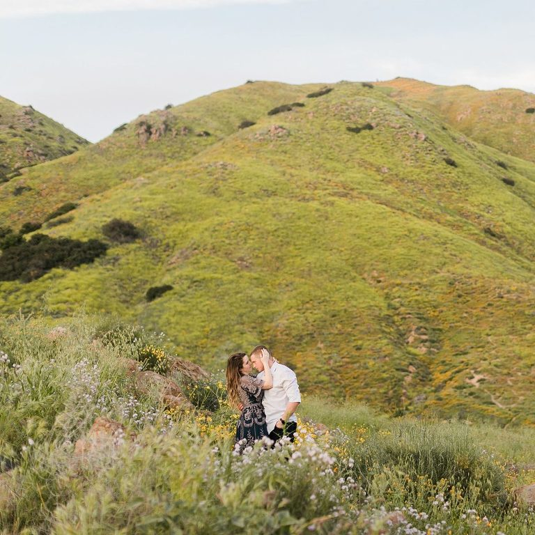 Lake Elsinore Wildflowers in the spring with couple kissing amongst them