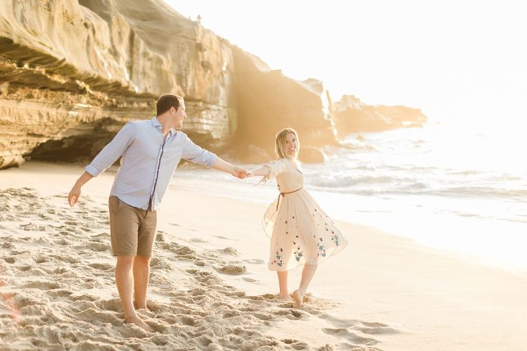 Engagement pictures at Wipeout Beach, La Jolla, CA during golden hour | Free People Dress