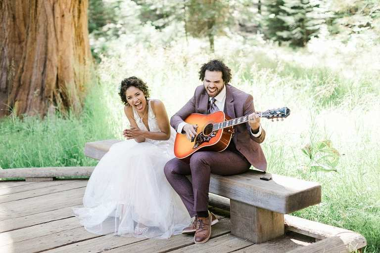 Groom playing guitar during Sequoia National Park elopement