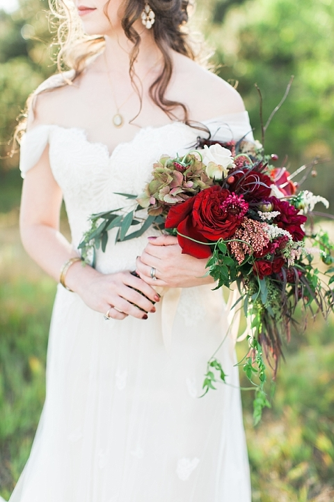 Cascading arm sheaf bouquet and gorgeous curls