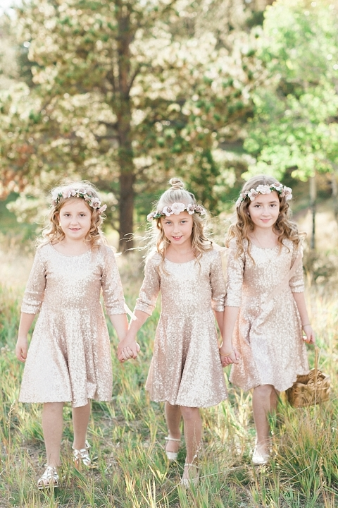 Flower girls in gold sequin dresses