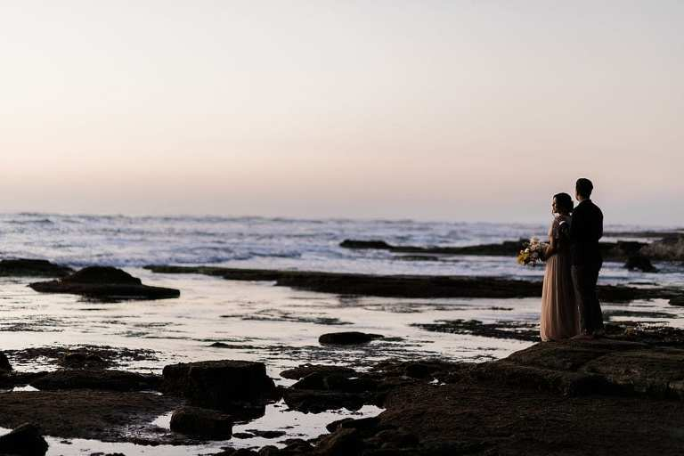 elopement couple watching the sunset