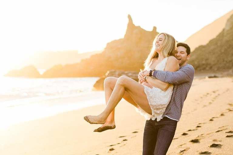 Black Sands elopement couple having fun