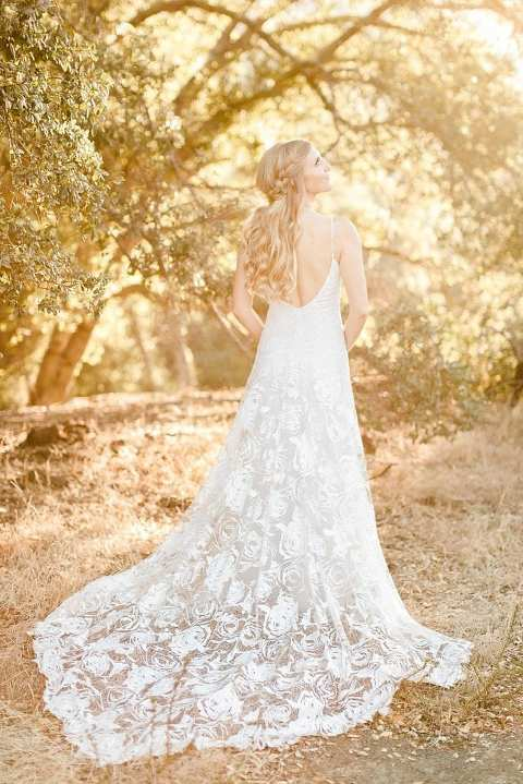 Beautiful glowy sunset light and a bride in a boho Grace Loves Lace gown