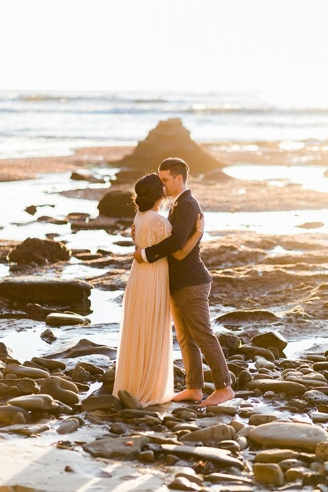 first kiss during elopement wedding ceremony at sunset cliffs park in San Diego