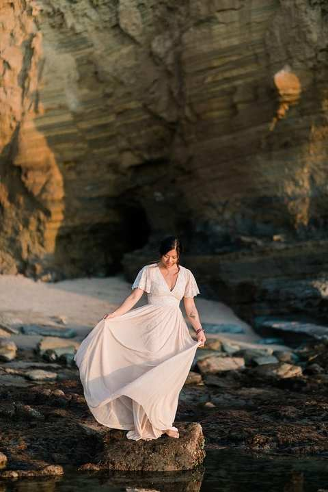 bride twirling at sunset cliffs elopement
