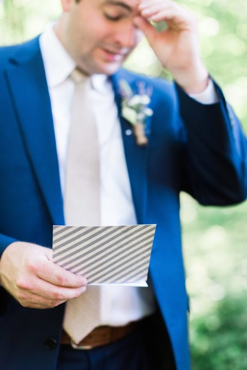 Emotional Groom reading a letter