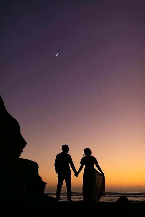 Silhouette of boho elopement couple and the moon